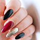 Spice up your red hybrid nails with black and glitter!